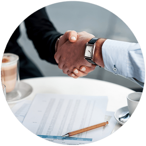 Solicitors shaking hands with their happy client